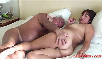 Horny couple having fun together on a bed