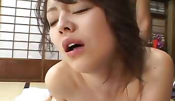 Horny mature Japanese cougar in a kimono rides a hard dick